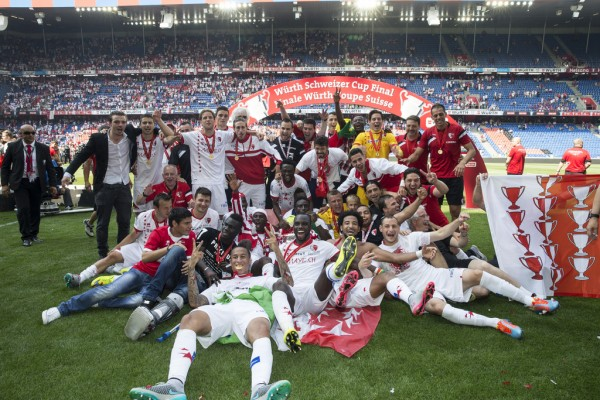 The Team of FC Sion celebrates the victory after the Swiss Cup final soccer match between FC Basel and FC Sion at the St. Jakob-Park stadium in Basel, Switzerland, Sunday, June 7, 2015. (KEYSTONE/Patrick Straub)